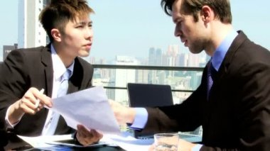 Business associates in rooftop restaurant — Stockvideo