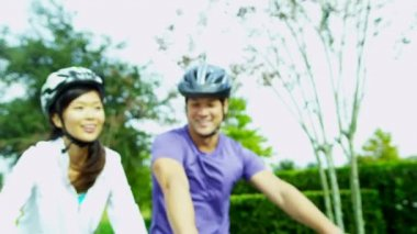 Happy Ethnic Couple Cycling Together Outdoors — Stock Video