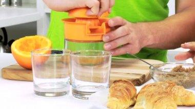 Hands squeezing fresh oranges — Stock Video