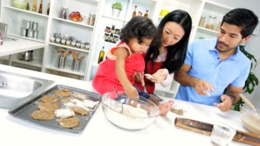 Girl with parents making cookie — Vídeo de stock