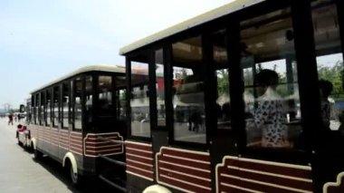 Tourist sightseeing passenger road train — Stock Video