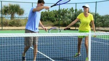 Tennis partners practicing racquet swing — Vídeo de Stock