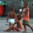 Small children playing at hillside favela in poor Urban housing — Stock Video #58469181