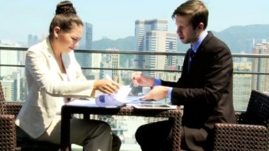 Business associates in rooftop restaurant — Vidéo