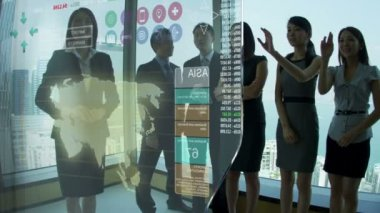 Asian Businessmen and Businesswomen using Motion Graphics Touchscreen — Stock Video