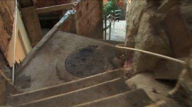 Walking hillside favela housing communities — Stock Video
