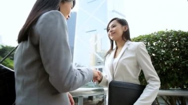 Businesswomen meeting and handshaking — Stock Video