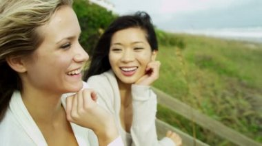 Women enjoying fresh air on beach — Video Stock