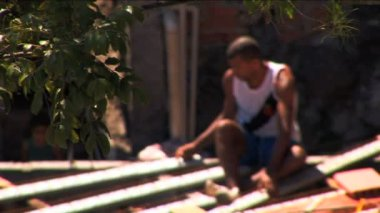 Blurred motion male worker in favela Urban housing — Stock Video