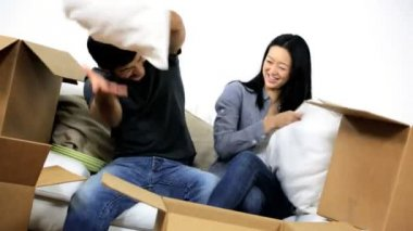 Couple fooling around with cushions — Stock Video