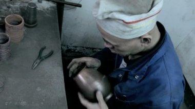 Pot maker examining manufactured item — Stock Video