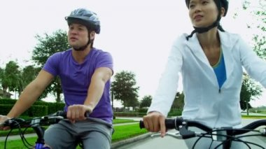 Couple enjoying together cycling outdoors — Stock Video