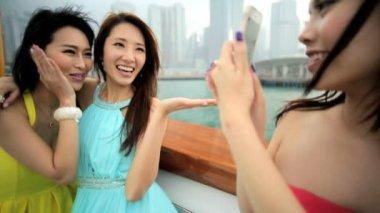 Girls taking photos on yacht — Stock Video