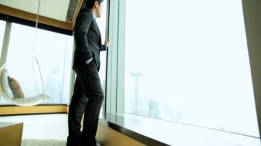 Businessman in hotel viewing cityscape — Stock Video