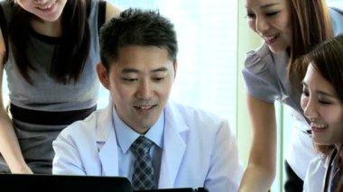 Doctors meeting in hospital boardroom — Stockvideo