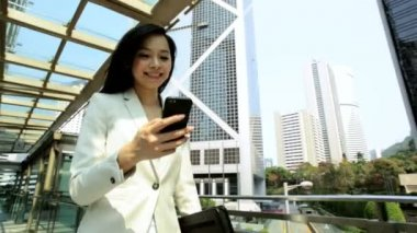 Businesswoman walking and using smartphone — Stock Video