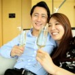 Young ethnic couple drinking champagne — Stock Video #58471839