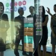 Asian Businessmen and Businesswomen using Motion Graphics Touchscreen — Stock Video #58476135