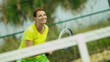 Woman enjoying game tennis — Vídeo de Stock