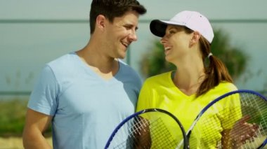 Tennis partners standing on tennis court — Stock Video