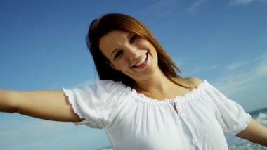 Woman having fun on beach vacation — Stock Video
