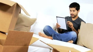 Man on couch using tablet — Stok video