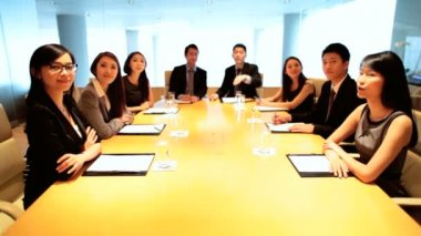 Male and female Asian business colleagues during  meeting at boardroom — Stock Video