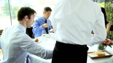 Financial investors in restaurant — Stock Video
