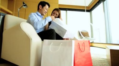 Asian couple with shopping bags — Stock Video