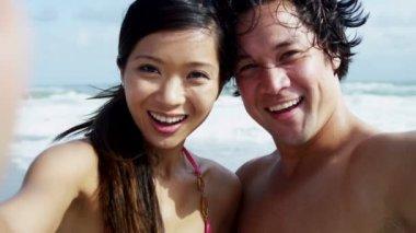 Couple having fun on beach — Stock Video