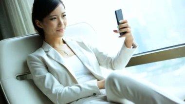 Businesswoman in hotel taking selfie — Stock Video