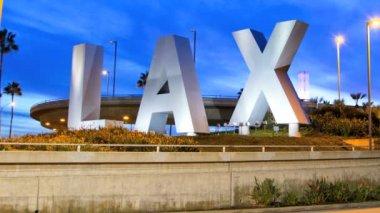 LAX sign dusk traffic International Airport Los Angeles USA — Stock Video