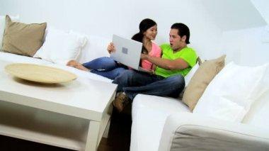 Couple seeing good news on laptop — Stock Video