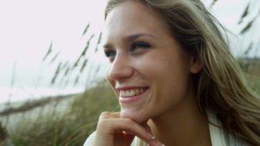 Girl enjoying time alone on beach — Stock video
