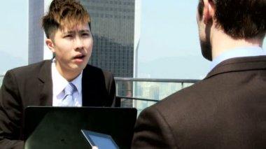 Business associates in rooftop restaurant — Wideo stockowe