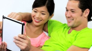Couple talking with friends via tablet — Stock Video