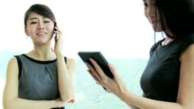 Businesswomen using smartphone and tablet — Stock Video