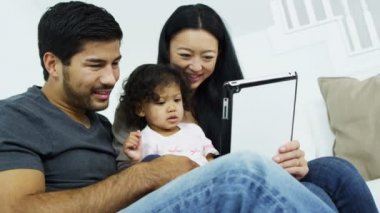 Couple with daughter playing on tablet — Stock Video