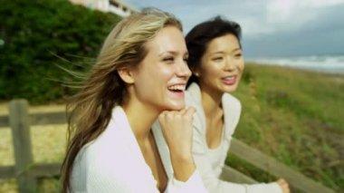Women enjoying fresh air on beach — Stock Video