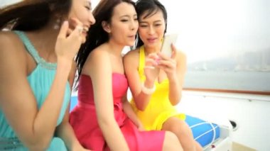 Girls on yacht watching photos — Stock Video