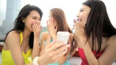 Asian girls having video conversation — Stock Video