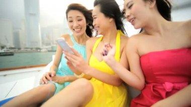 Girls on yacht watching photos — Stock Video