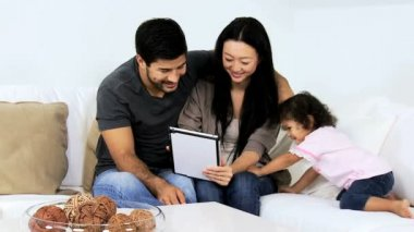 Parents with daughter using tablet — Stock Video
