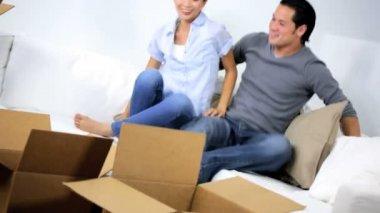 Couple taking break from unpacking Cartons — Vidéo