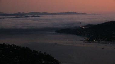 Aerial sea fog sunset San Francisco Bay Golden Gate — Stock video