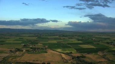 Aerial USA Idaho sunset farming crops vegetation field arable farmland — Stock Video