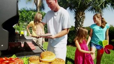 Parents with daughters grilling barbecue meat — Stock Video