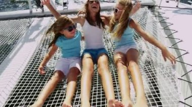 Young sisters having fun on luxury yacht — Stock Video