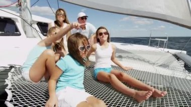 Mother and father with smiling girls  on yacht — Stock Video