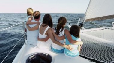 Family with children having fun on luxury yacht — Stockvideo